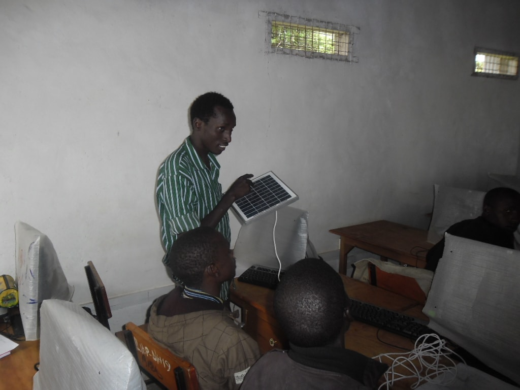 Youth showing colleagues the arrangement of solar cells in a solar panel during the training in Ilkerin Loita